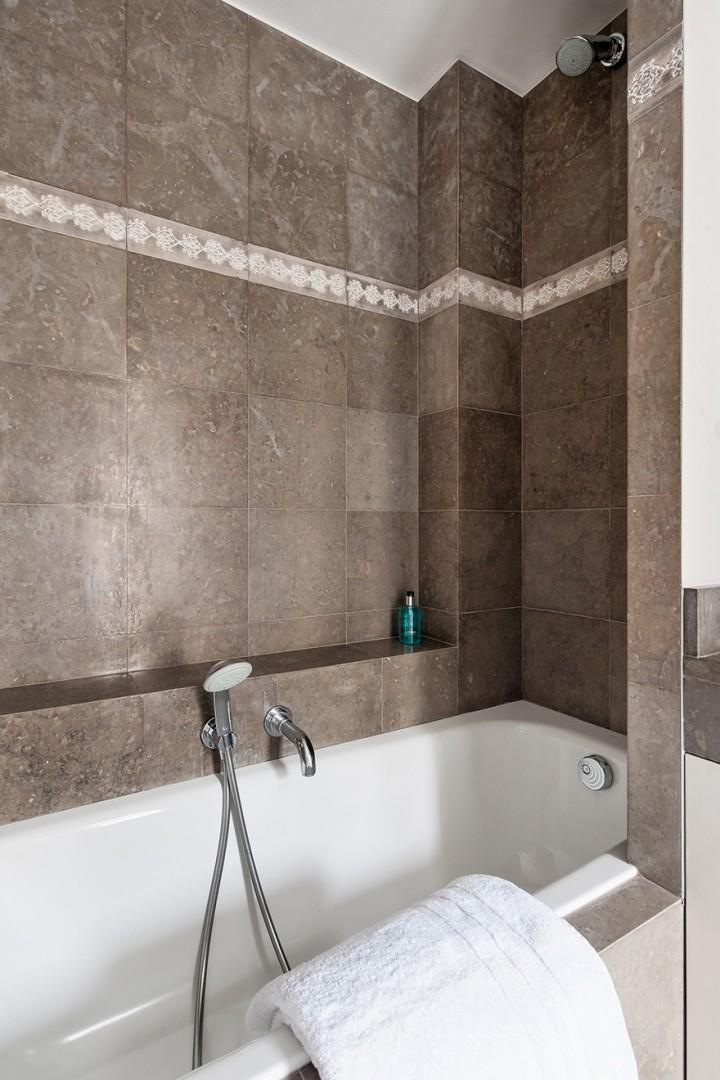 Fixed and handheld shower heads in the bathroom