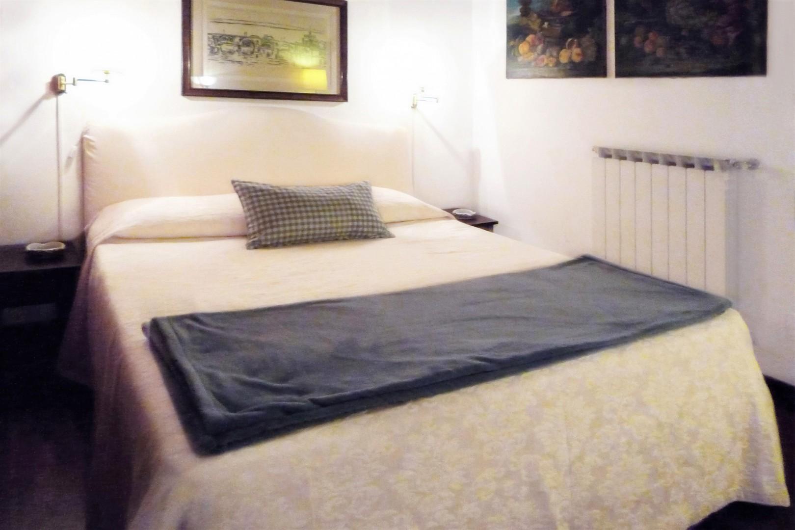 Bedroom doorway opens directly to the living room, but there is no door.