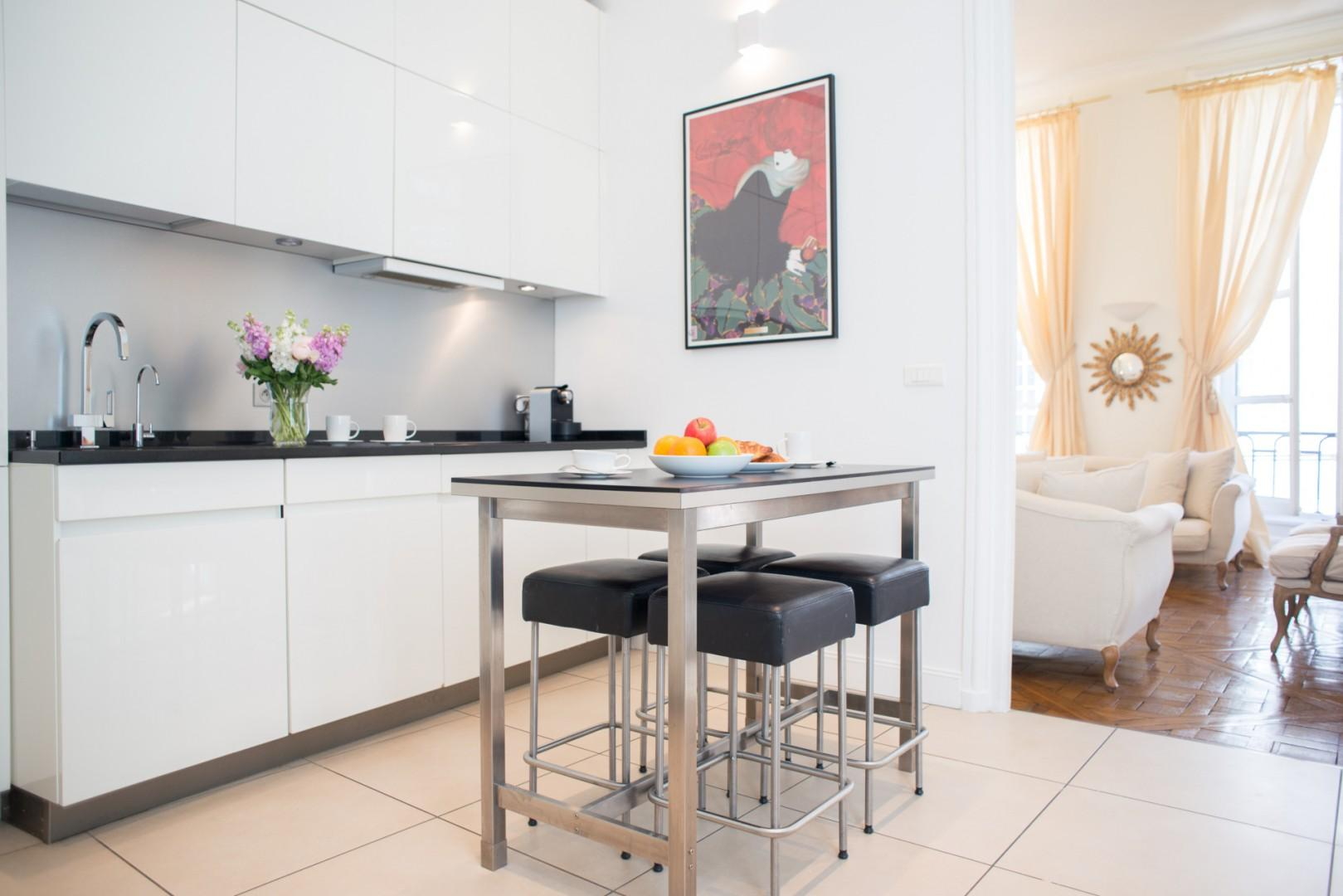 The sleek kitchen table is perfect for cooking or casual dining.