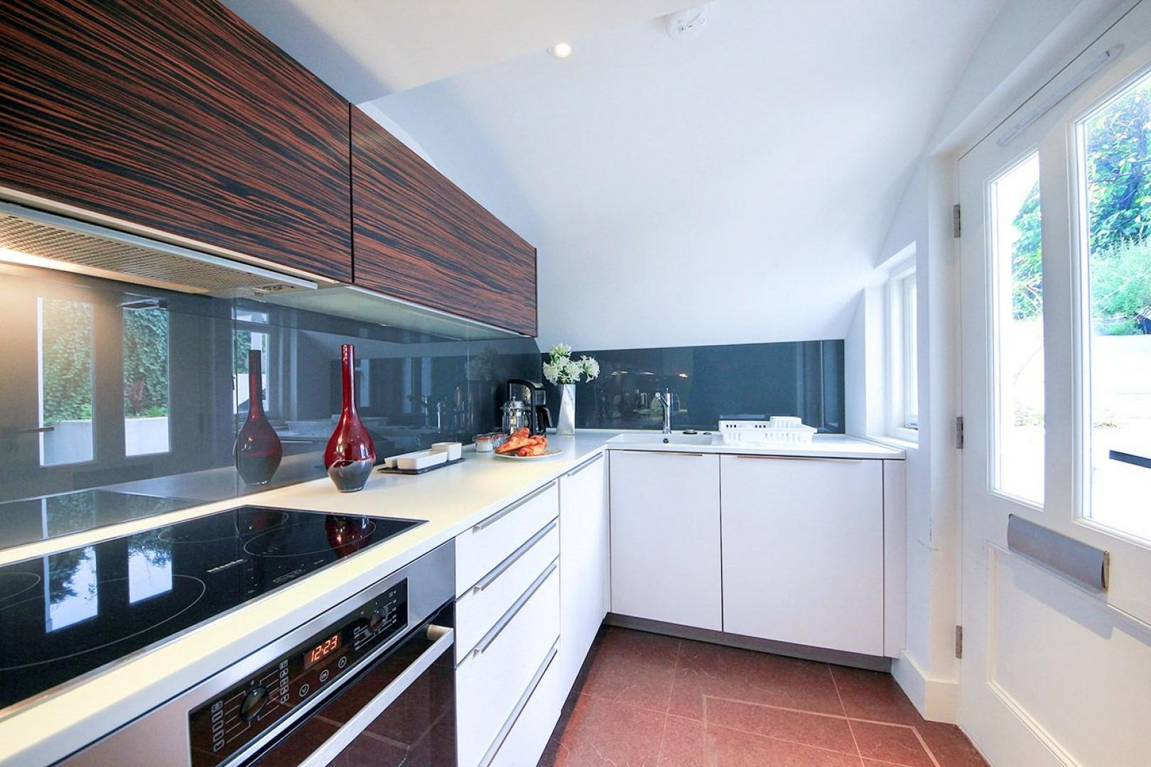 View towards the sink area of the stylish apartment kitchen