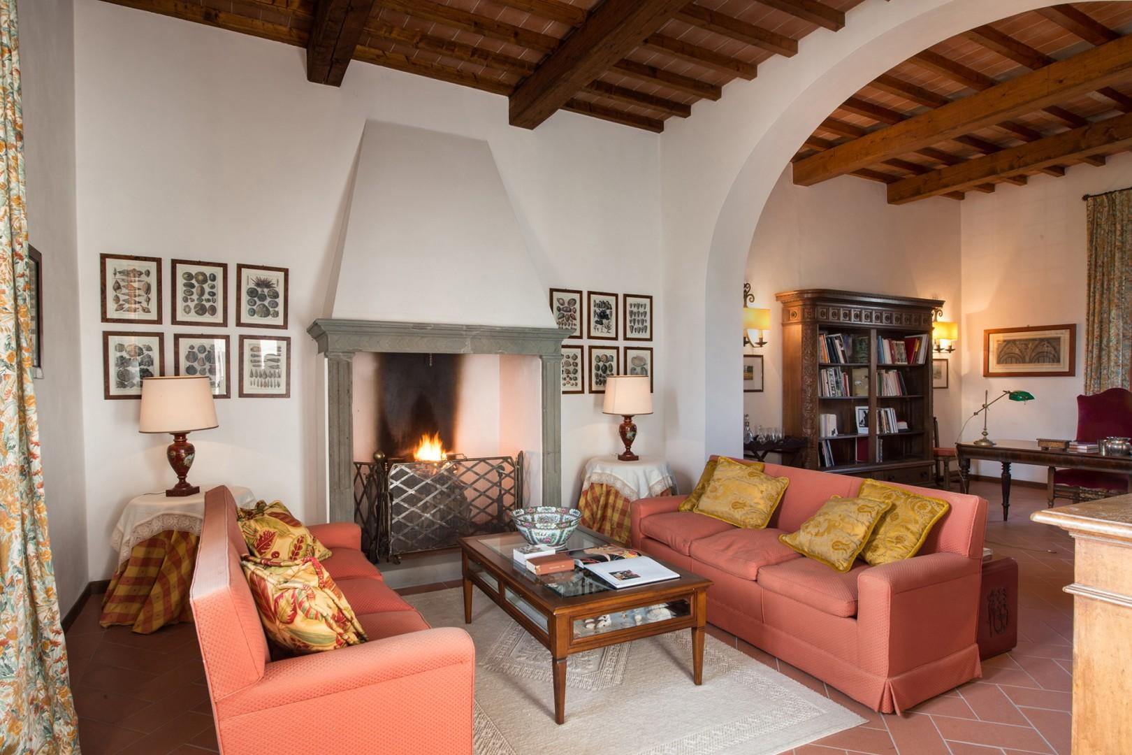 Living room with working fireplace is the perfect gathering spot.