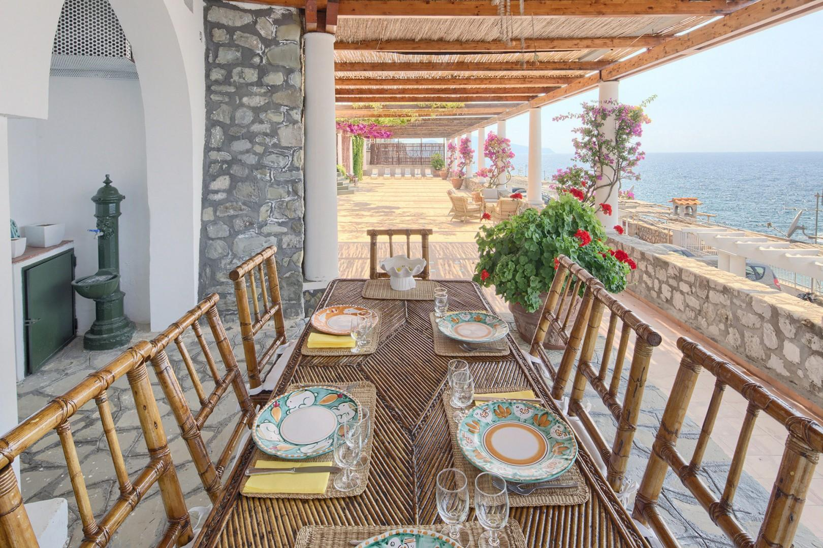 The outdoor dining room has a roof for comfort and shade on the hottest days.