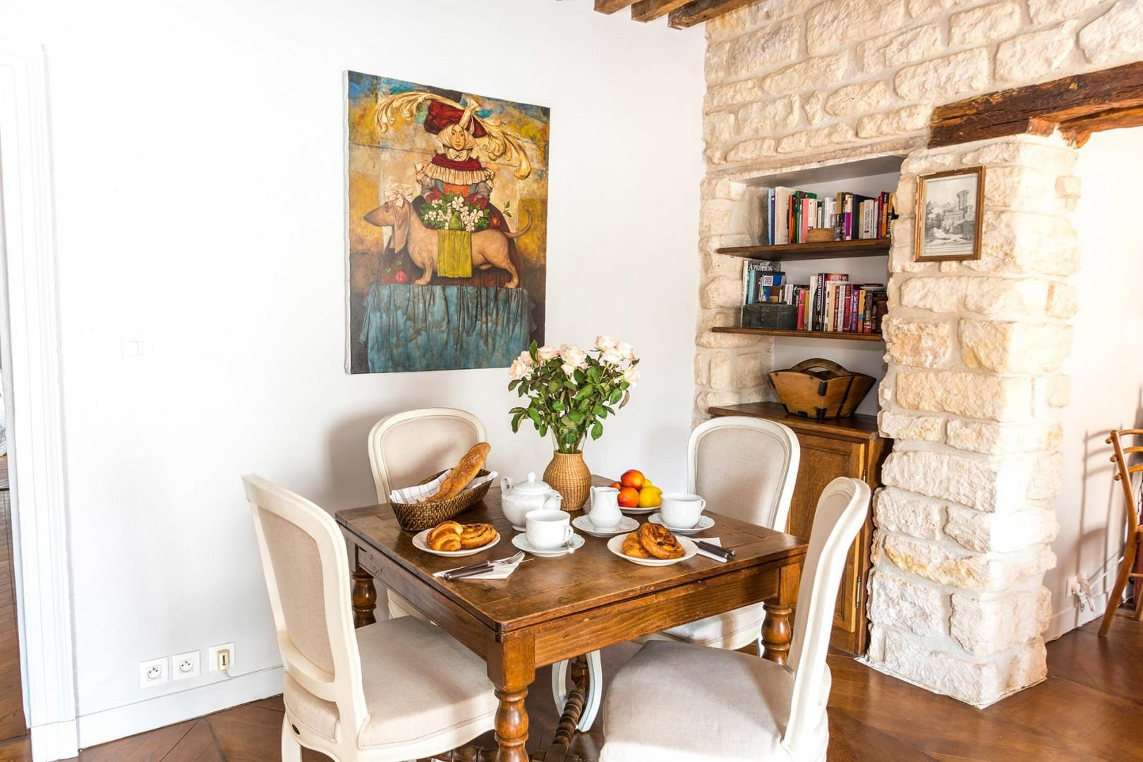 The beautiful oak dining table sits four guests.