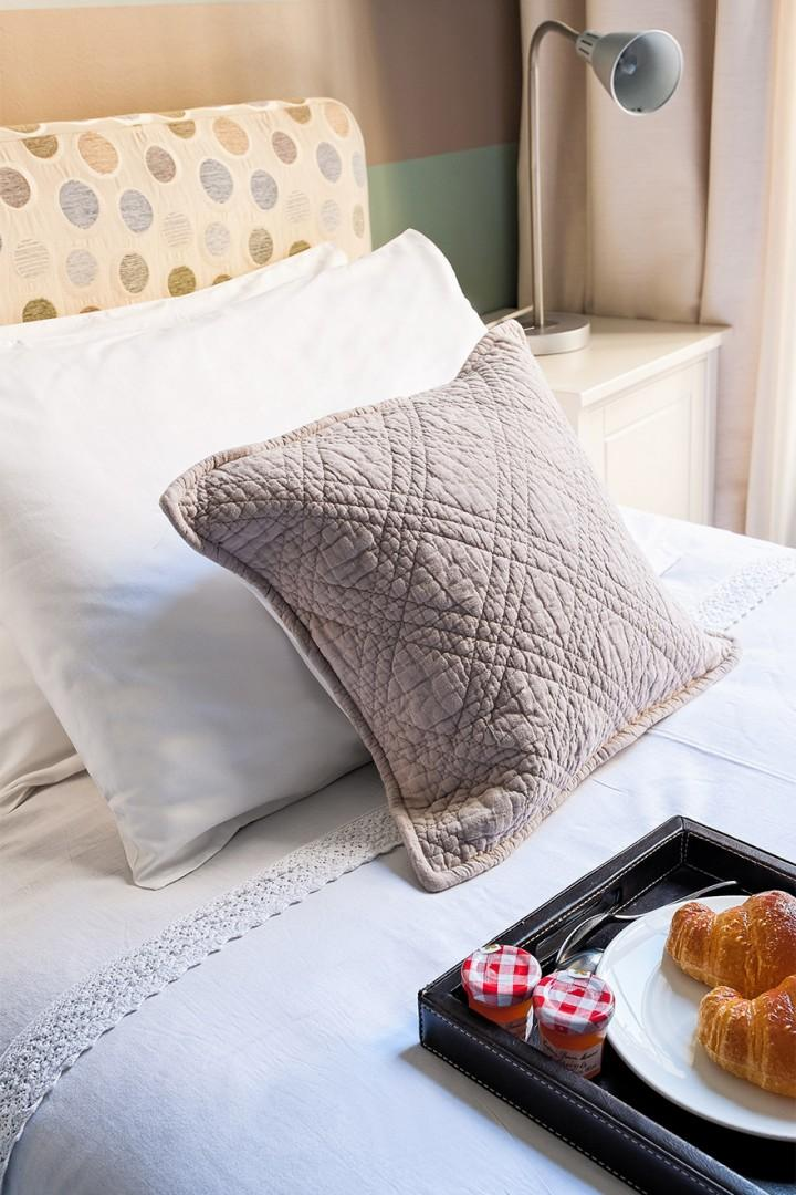 Soft pillows add extra comfort to the beds.