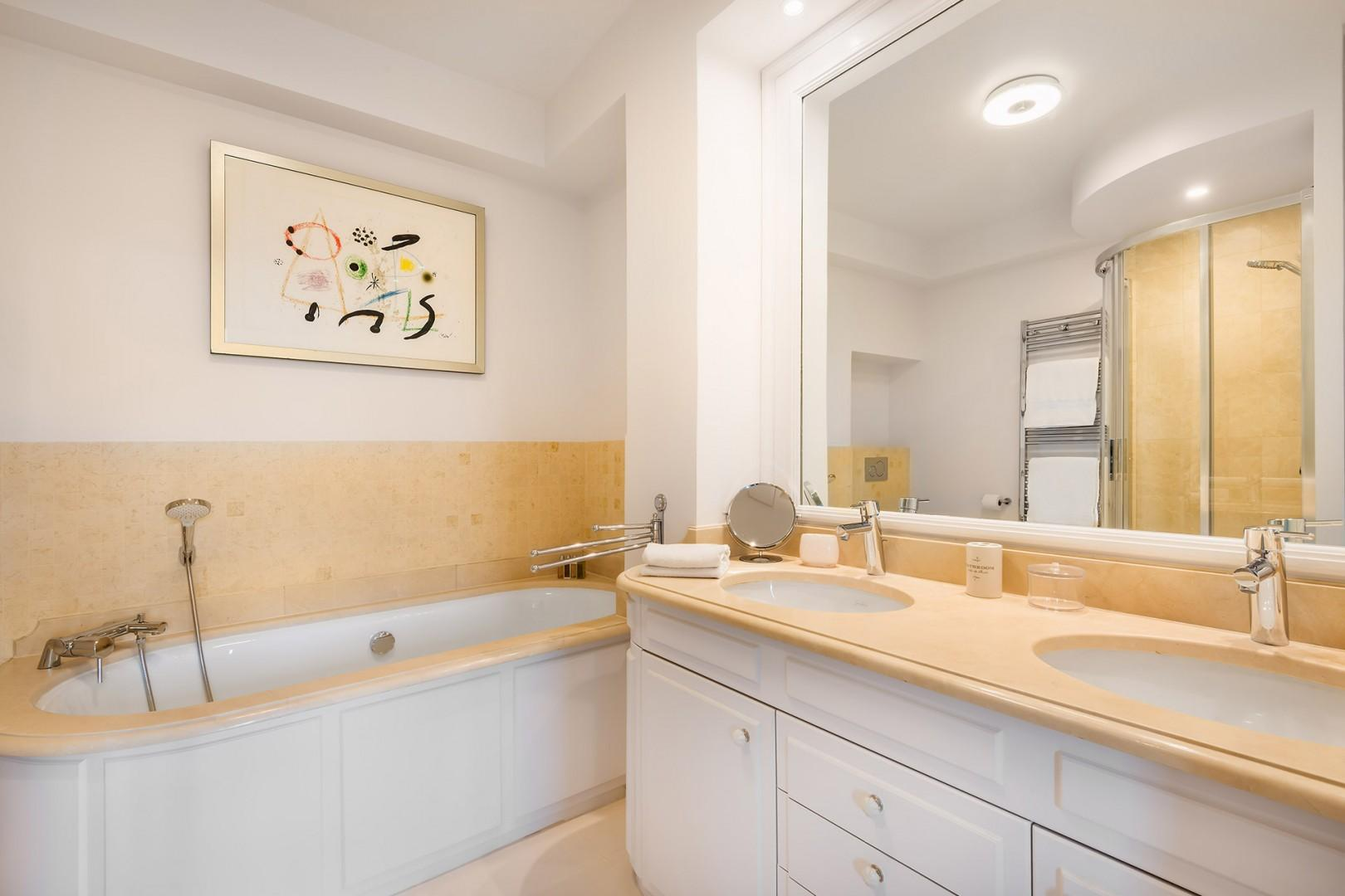 The luxurious bathroom 1 with a bathtub is fit for a royal!