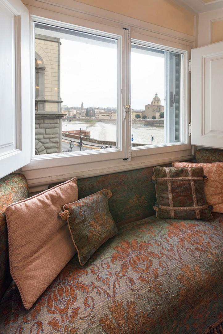 Cozy window seat behind the desk in the office, great for gazing at the view.
