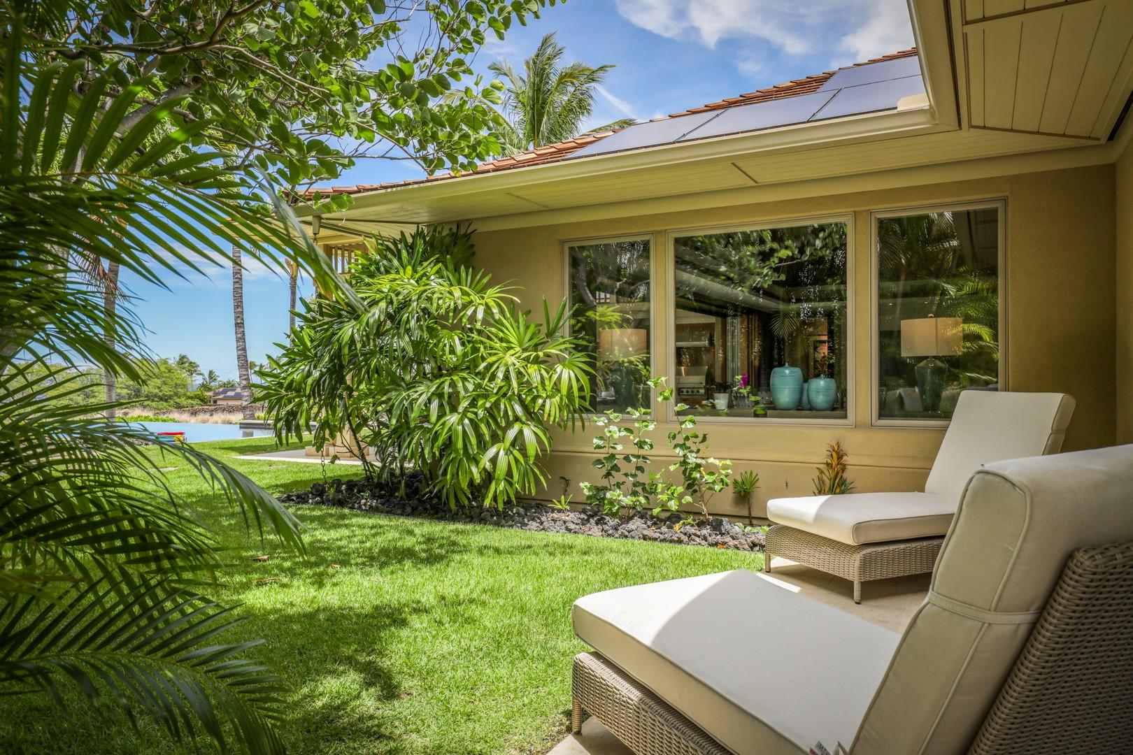 Private lanai with tropical landscaping outside Guest Room 2.
