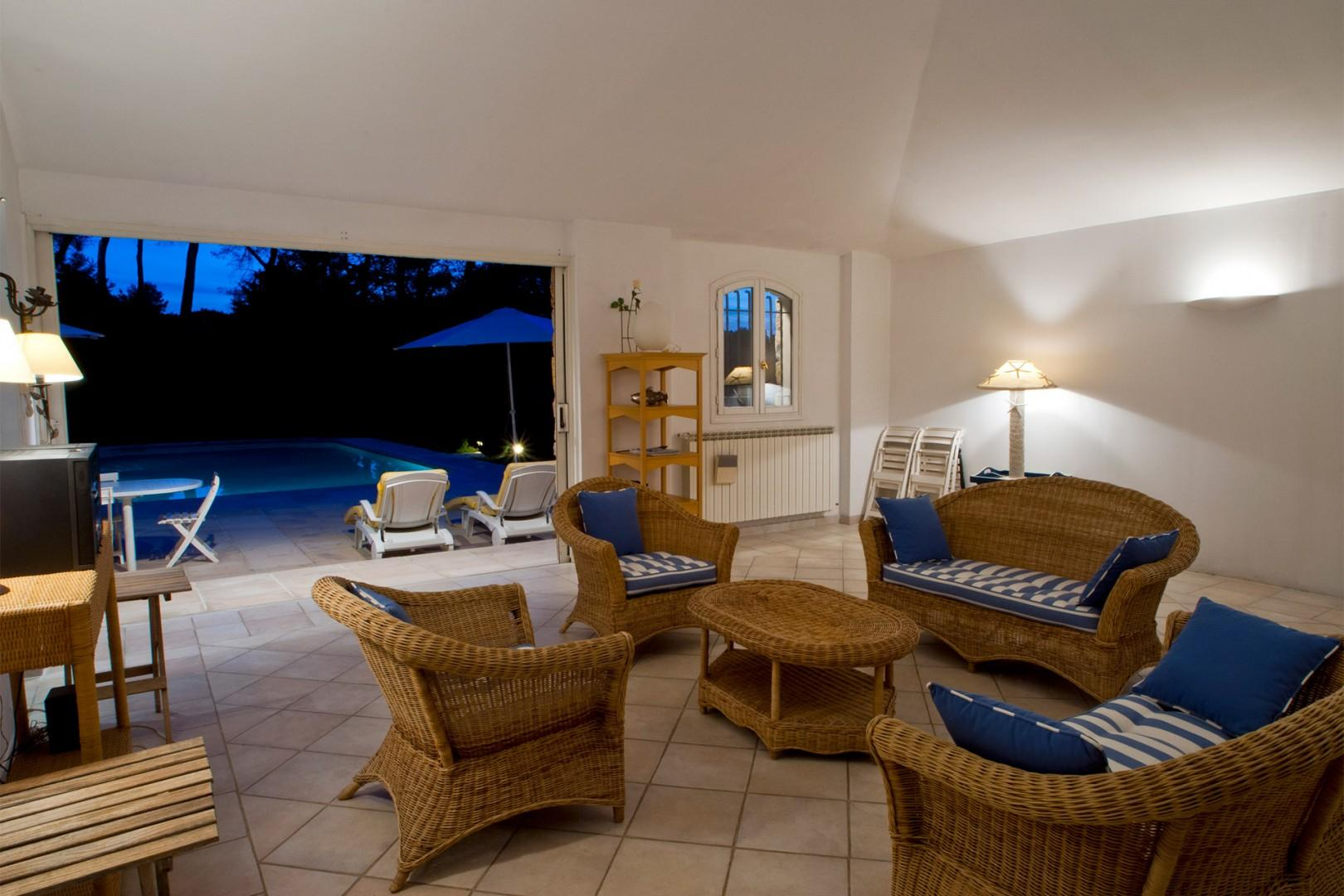 Comfortable pool house with lounge area perfect for entertaining