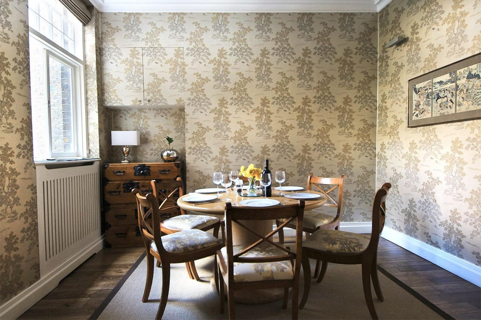 Stylish formal dining room located near the kitchen