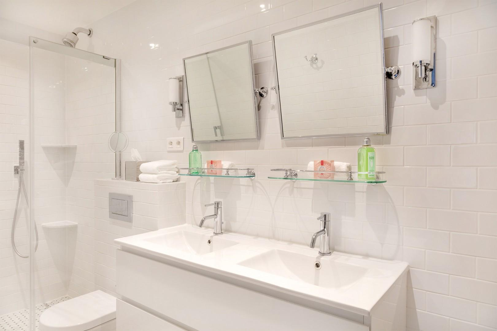 The en suite bathroom is equipped with a shower, toilet and double sink.