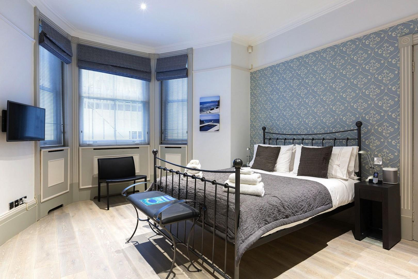 Bedroom 1 is spacious, comfortable, and bright, for a restful stay