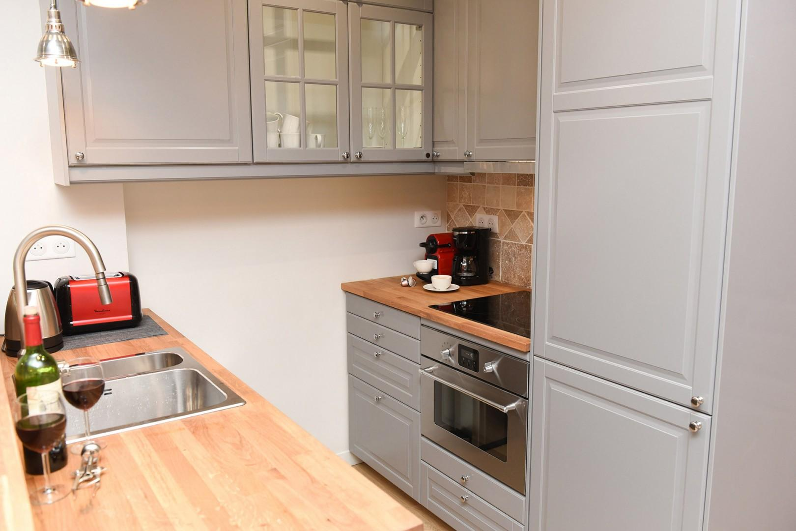 The fully equipped kitchen is great for easy meal preparation.