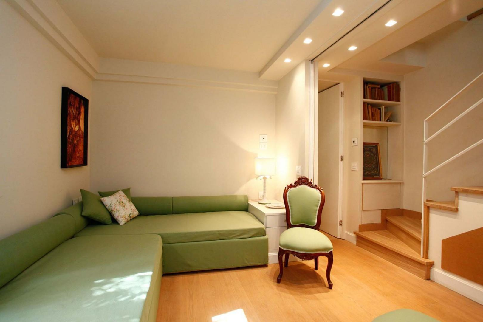 This space can be used as a lower level living room or bedroom with two day beds.