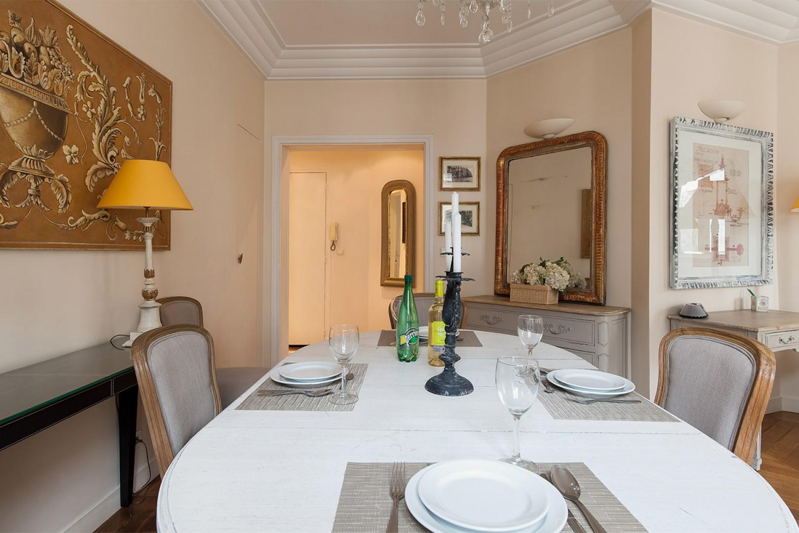 The dining table opens up to seat six guests.