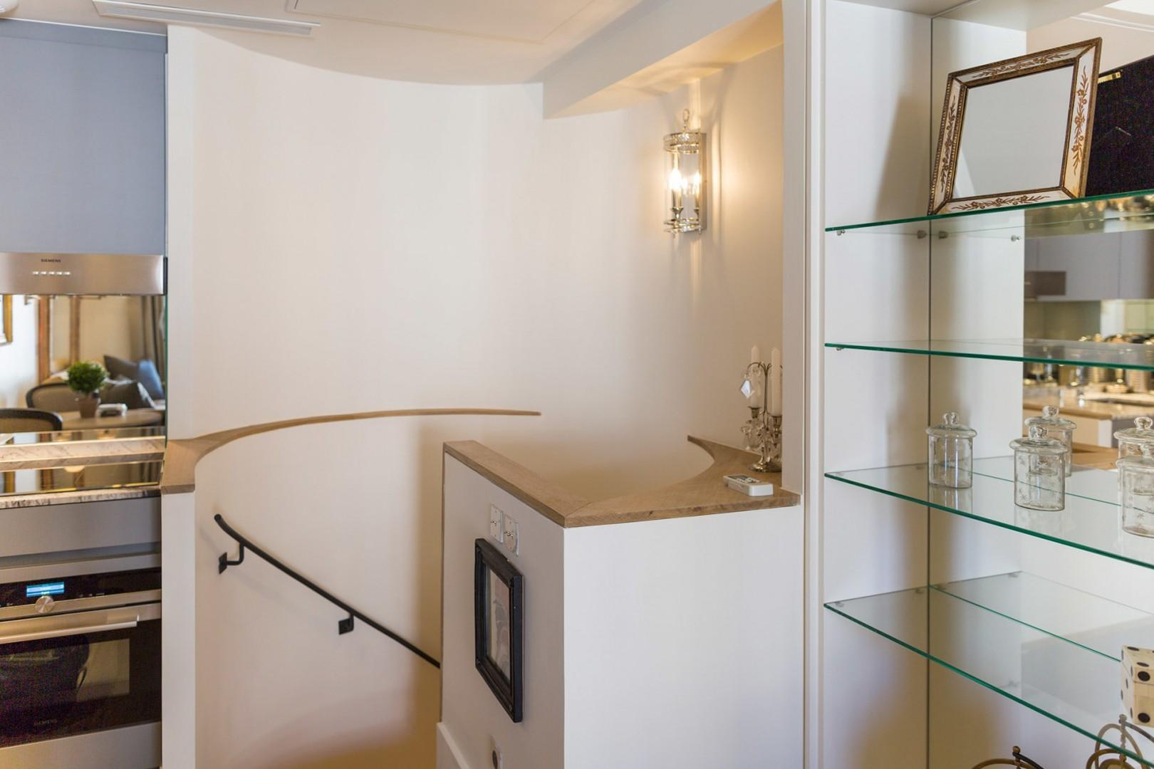 Staircase leading to the bedroom and en suite bathroom