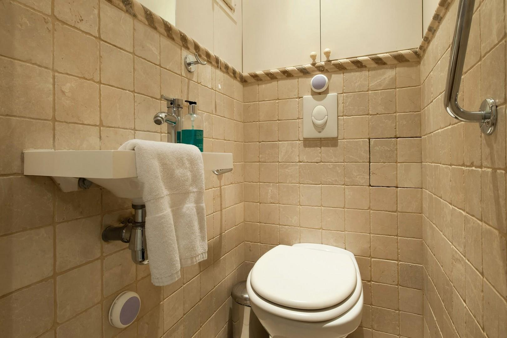There is a practical separate half bath.