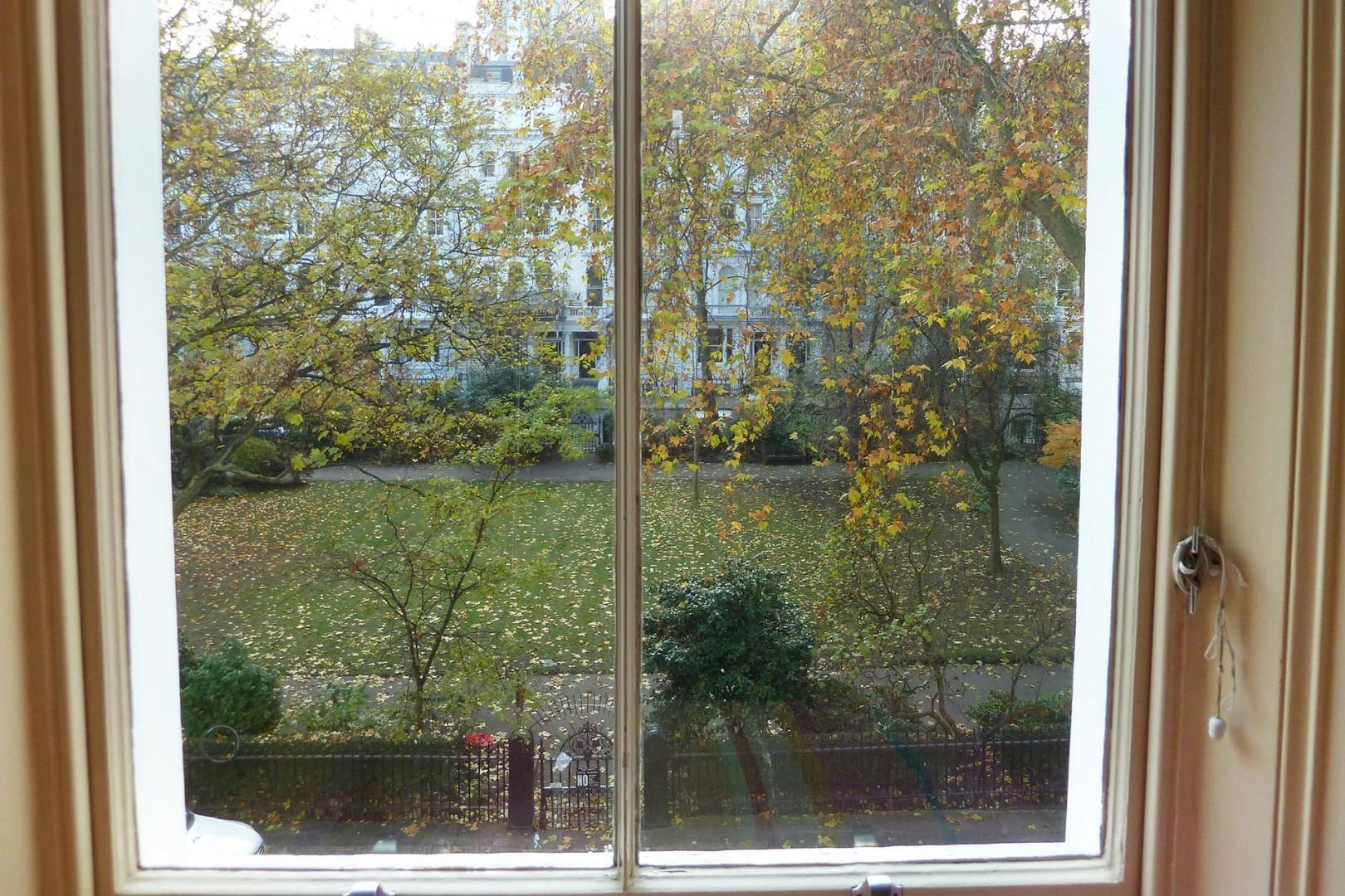 View to the garden from the living room and first and third bedrooms