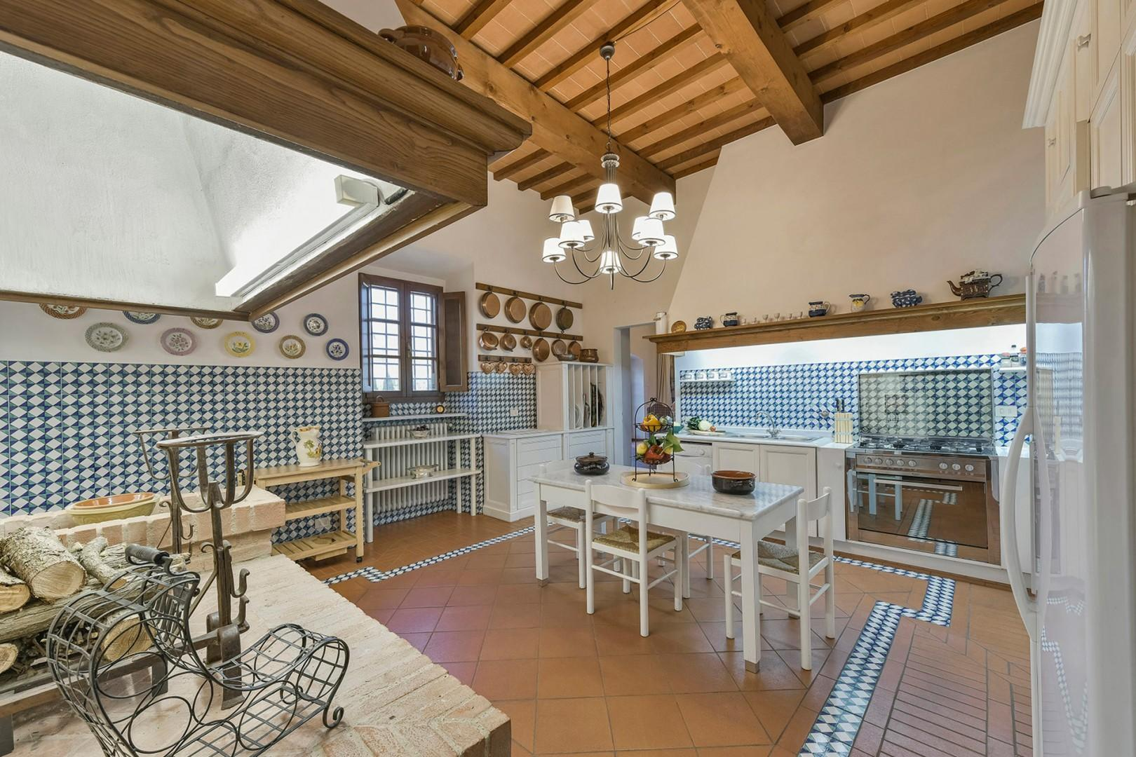 Beautiful fully-equipped kitchen with an original fireplace.