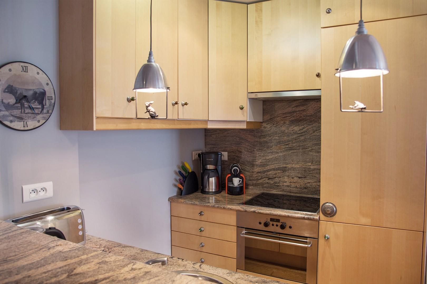 The fully equipped kitchen has a suite of modern appliances.