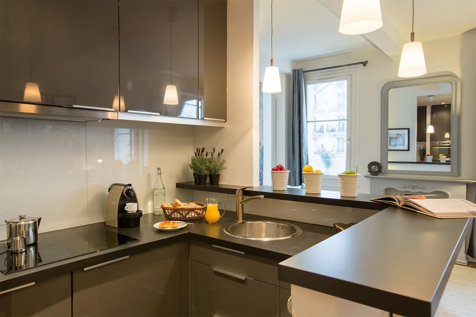 Preparing meals at home is a pleasure in the beautiful modern kitchen.