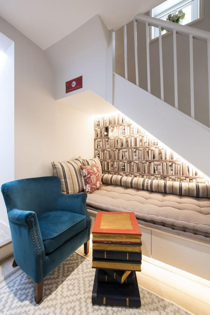 Get cozy in this little nook under the stairs