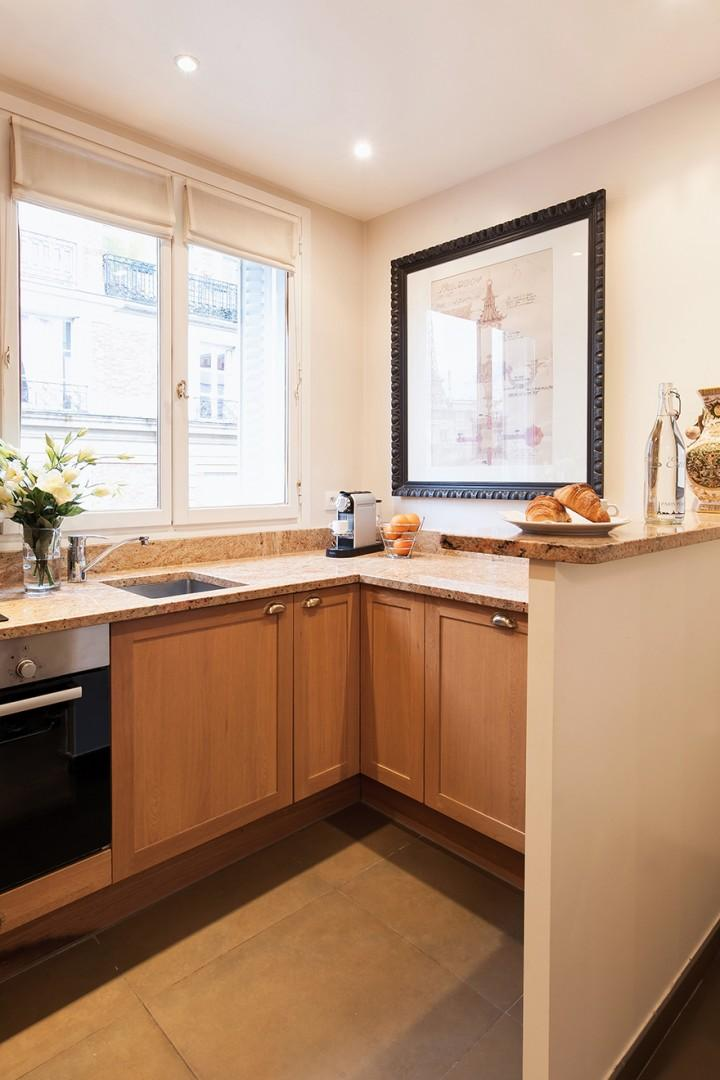 Large windows in the kitchen let in lots of natural light.