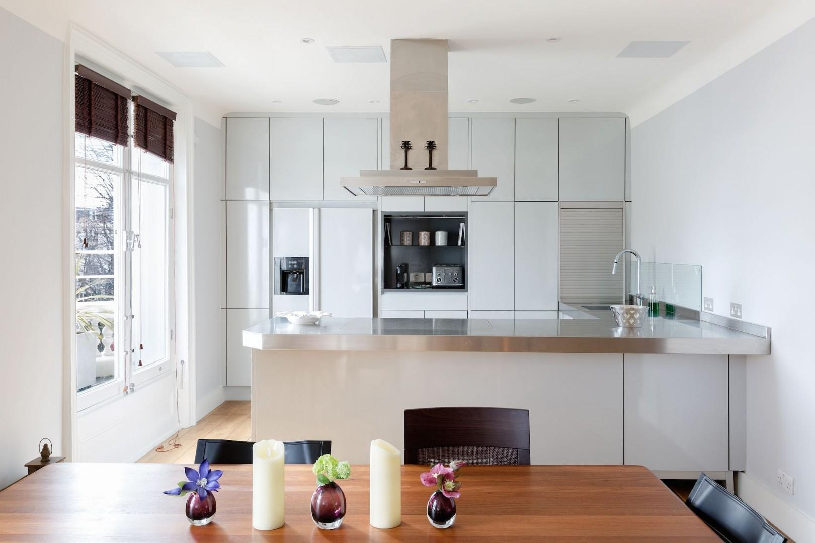 The fully-equipped kitchen is modern and sleek