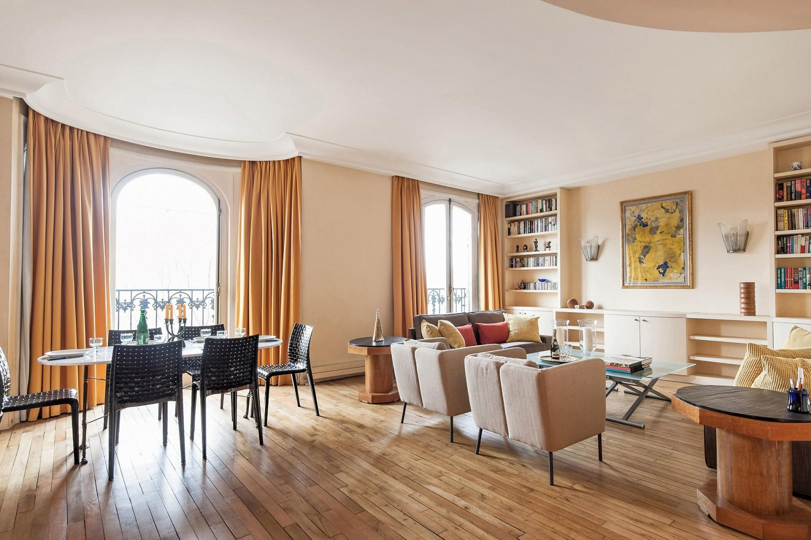 The gracious living and dining areas are brightened by picturesque arched windows.