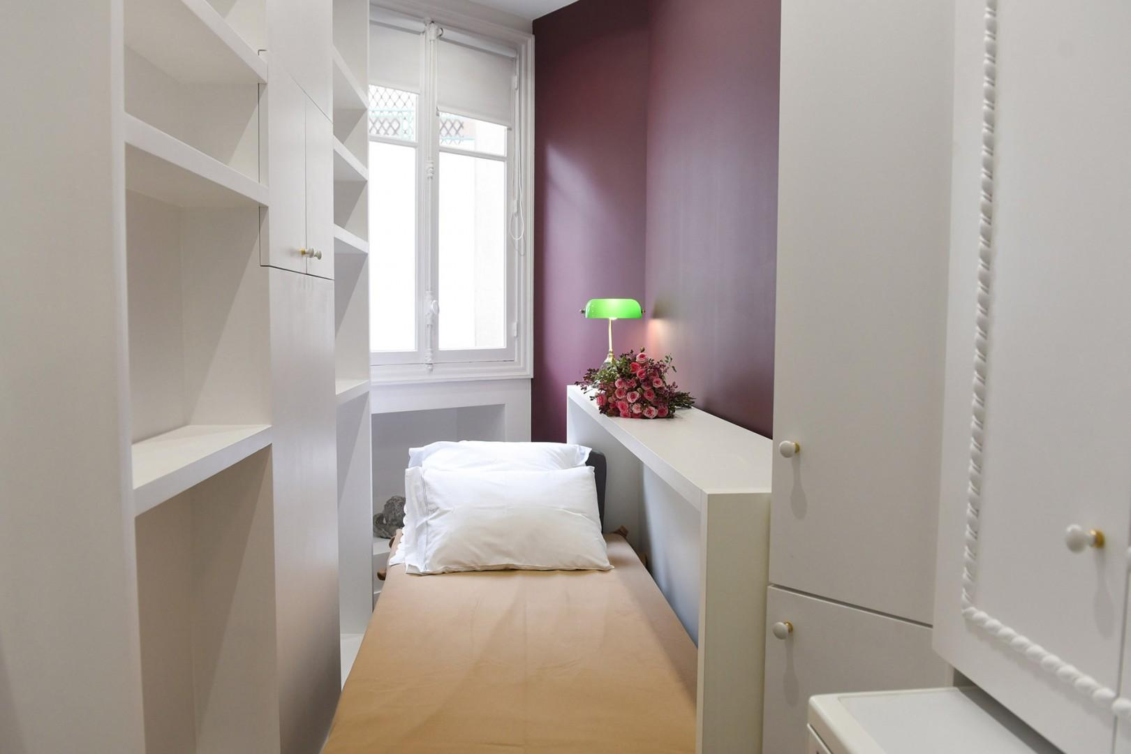 Bedroom 3 has a bed that folds open to create an extra sleeping space.