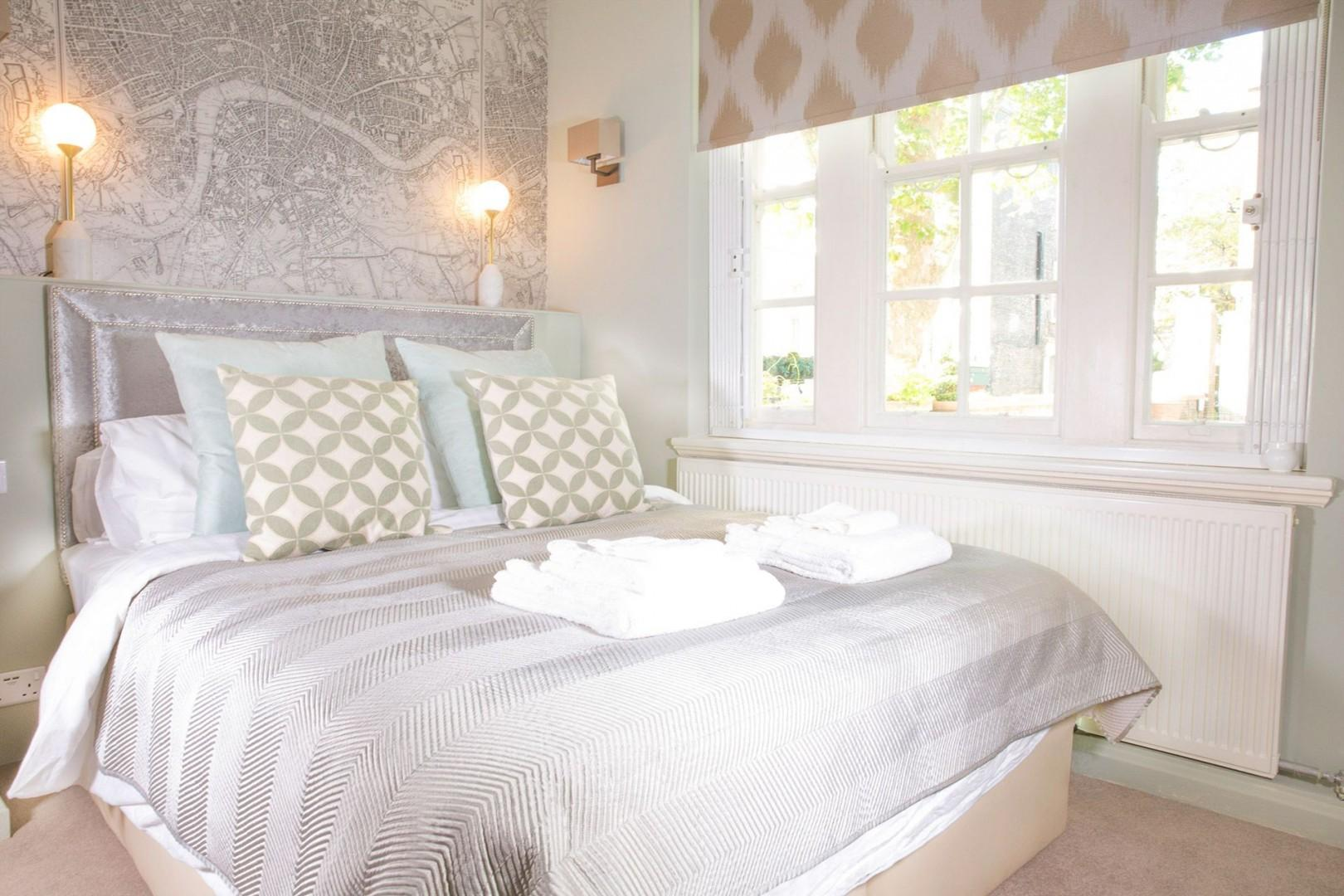 The first bedroom with comfortable bed that can be unzipped to form two beds