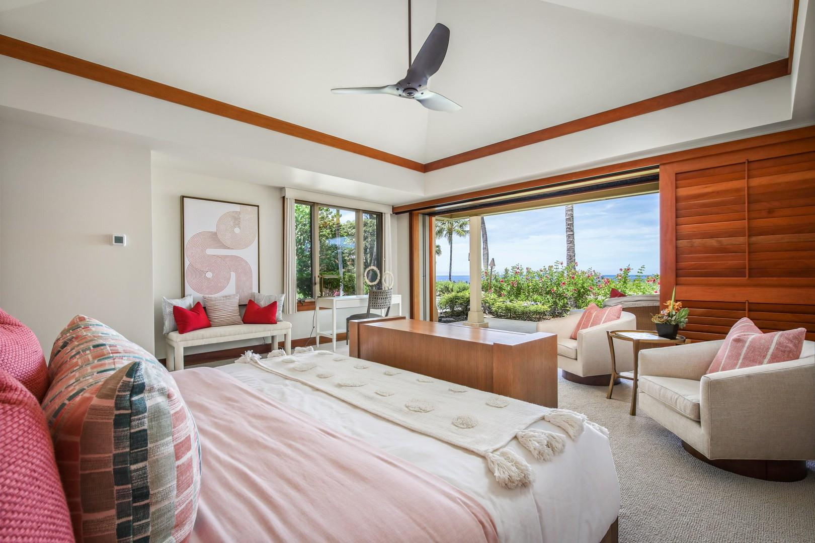 Master bedroom suite with seating area, private lanai, en suite bath and ocean views.