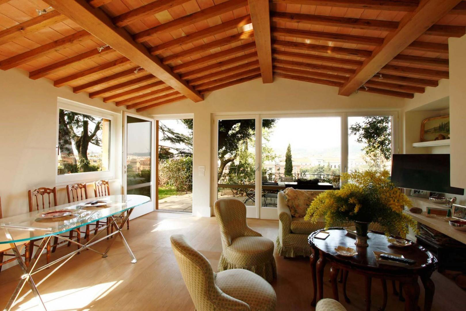 Light filled living room overlooks the terrace and the city.