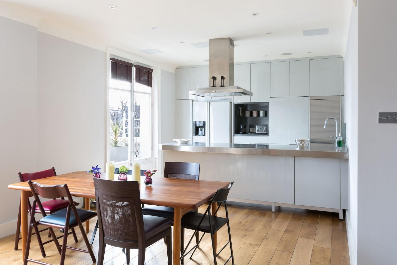 The kitchen is fully equipped with appliances and amenities