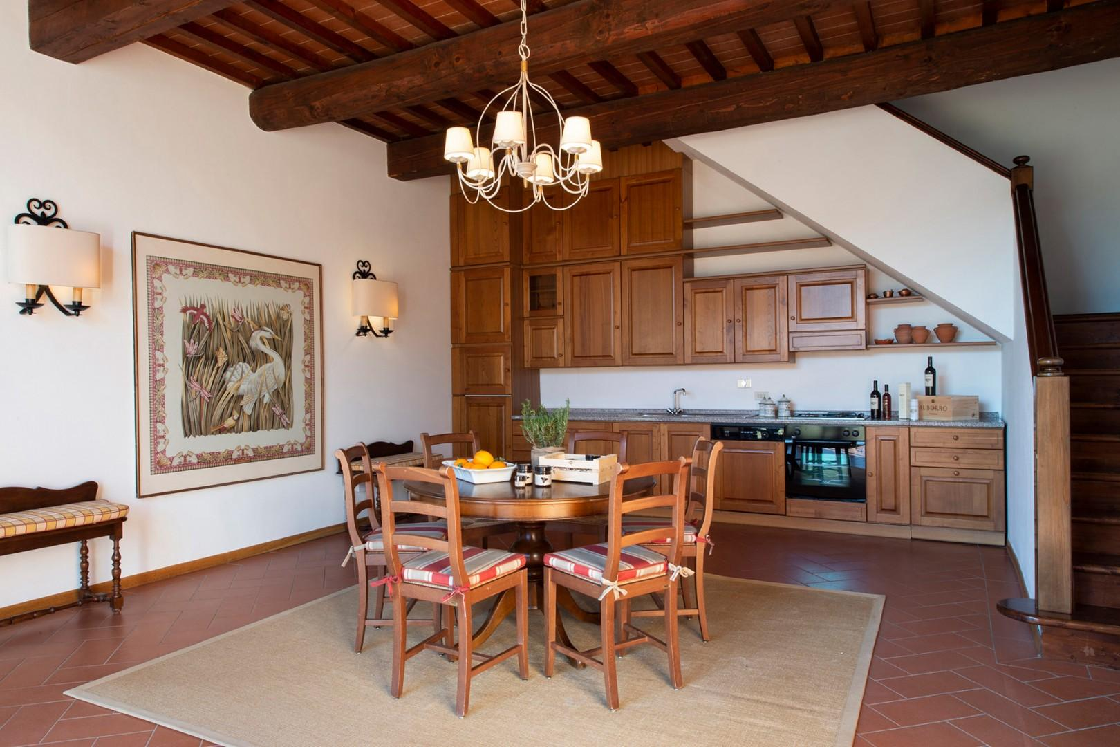 Dining room and fully equipped kitchen.