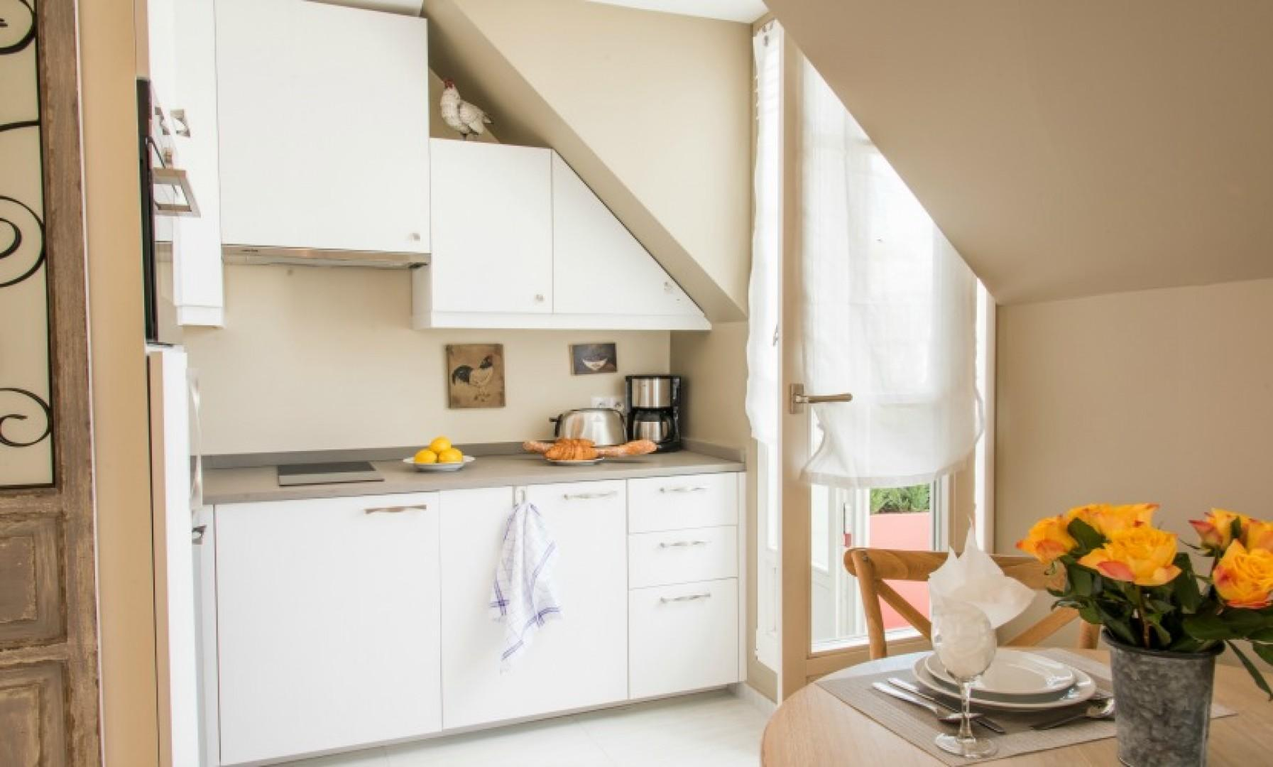 A door to the balcony is available in the kitchen.