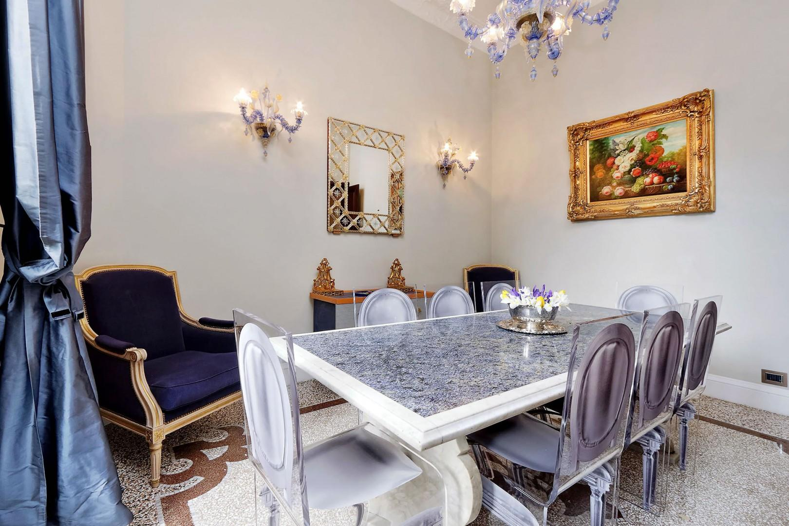 The table is made of striking deep blue marble and comfortably seats 8.