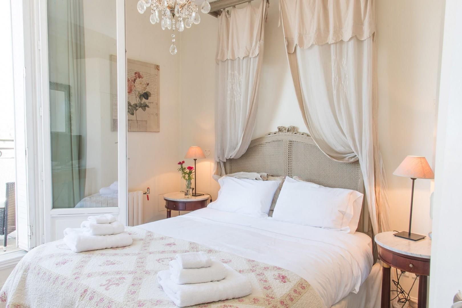 Relax in the romantic bedroom, decorated with a French flair.