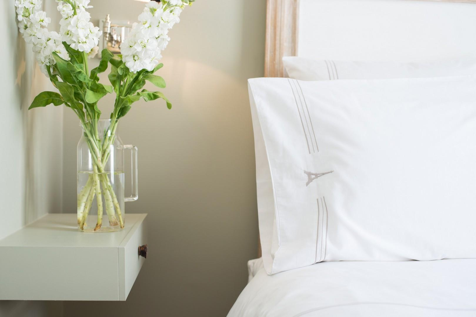 Soft lighting and luxury linens give the bedroom a romantic feel.