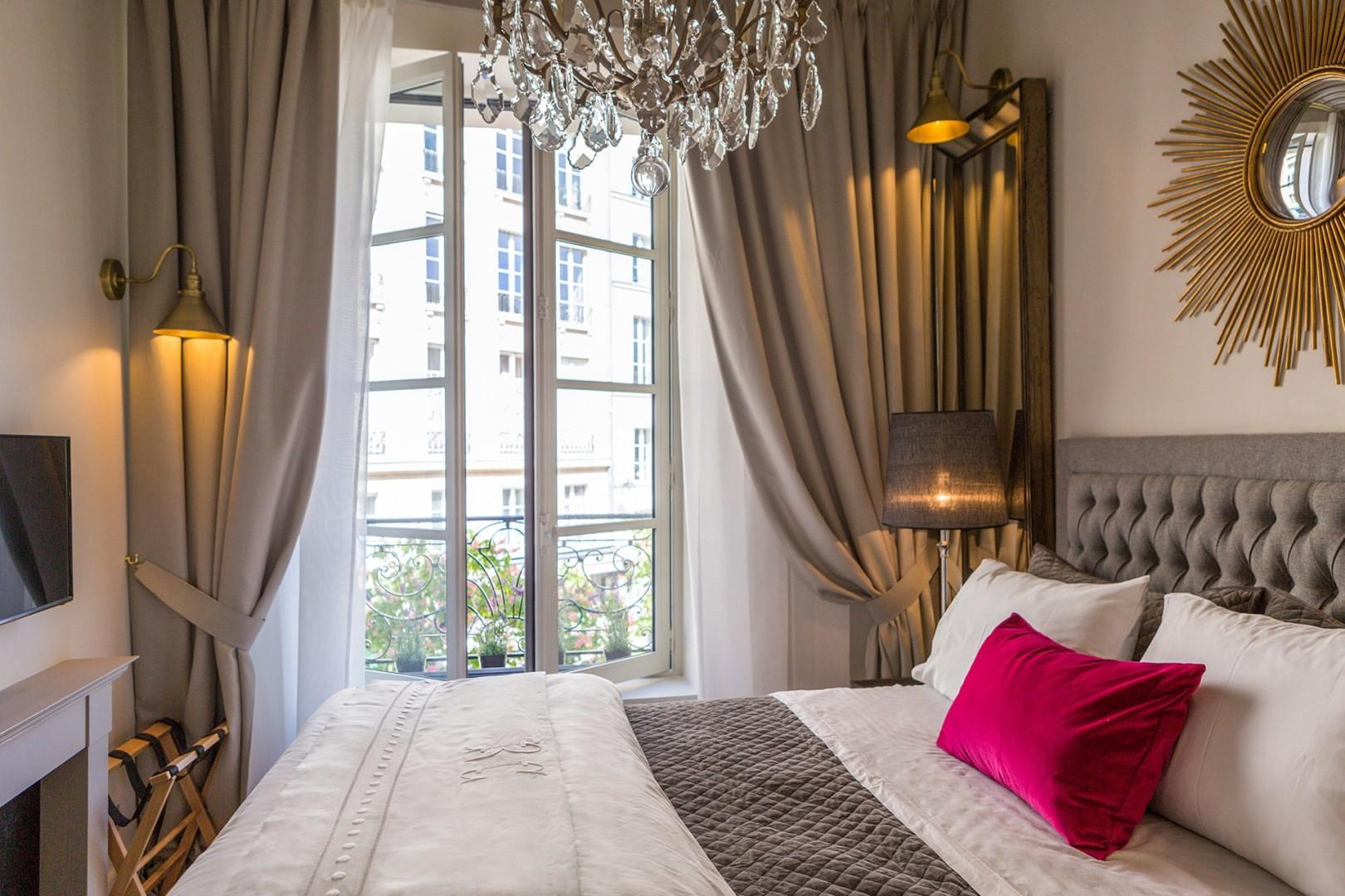 View of the stunning Place Dauphine from the bedroom