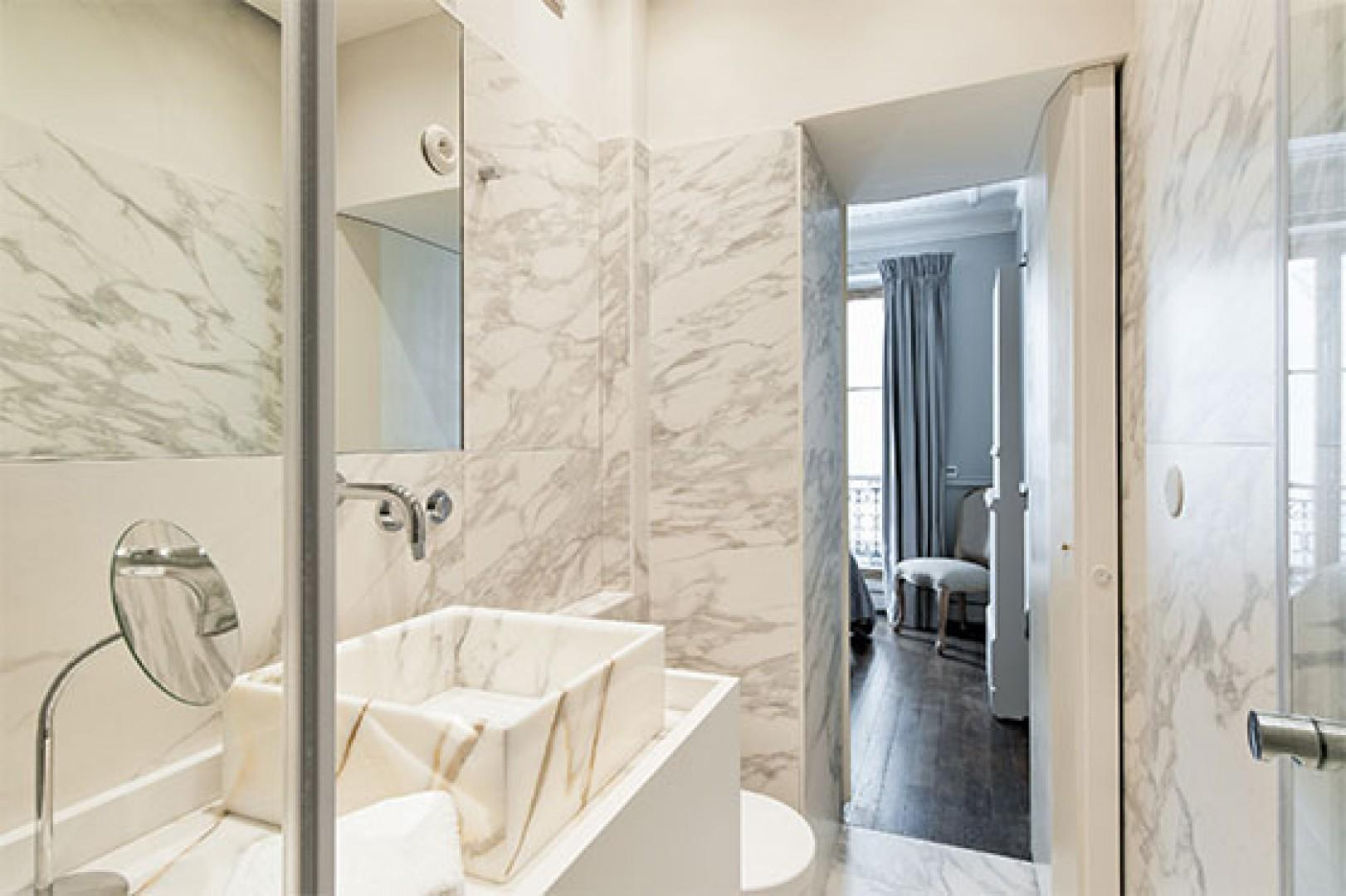 Pamper yourself in the luxurious marble bathroom.