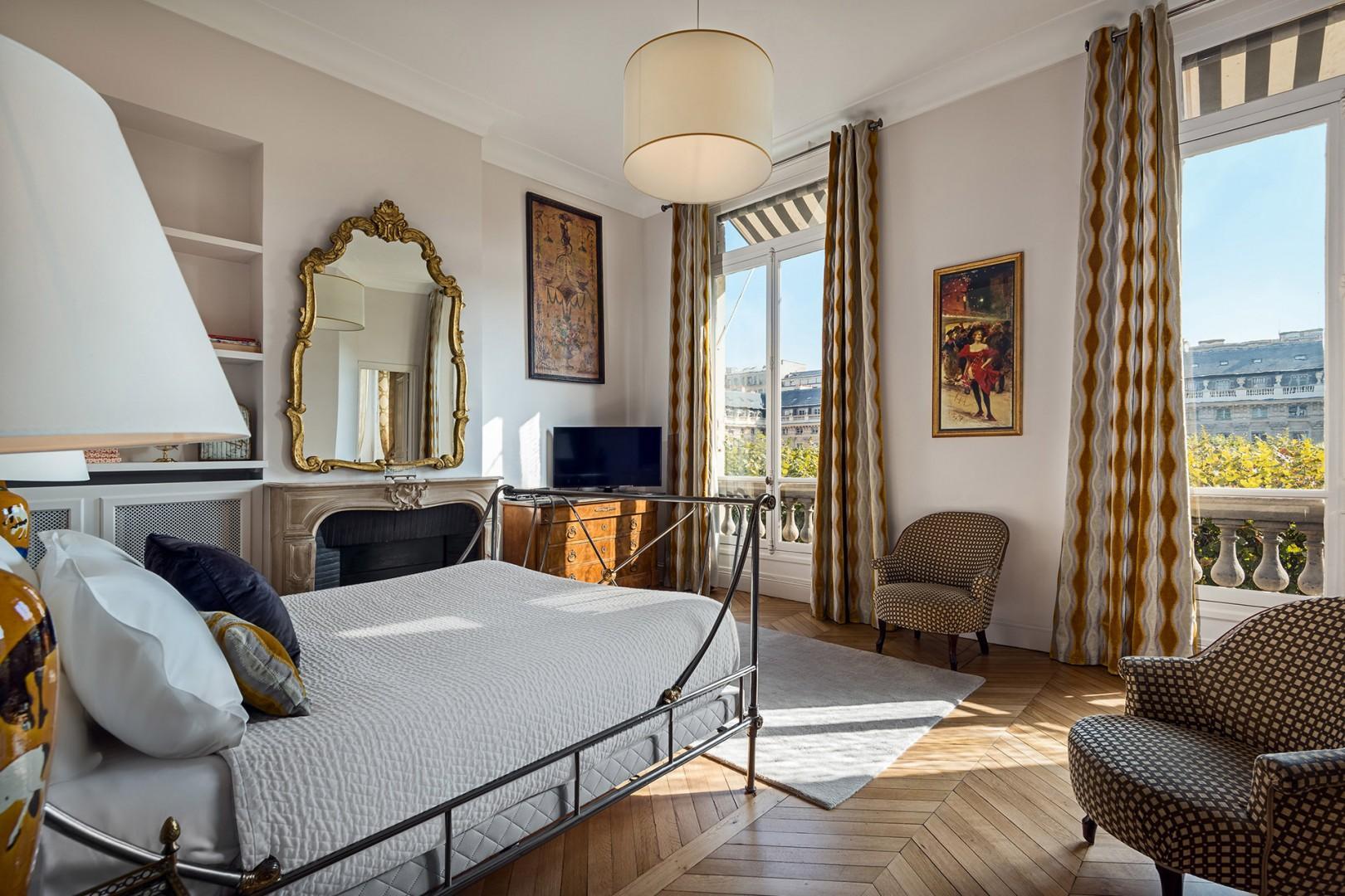 A sense of grandeur is evident in the bedroom.