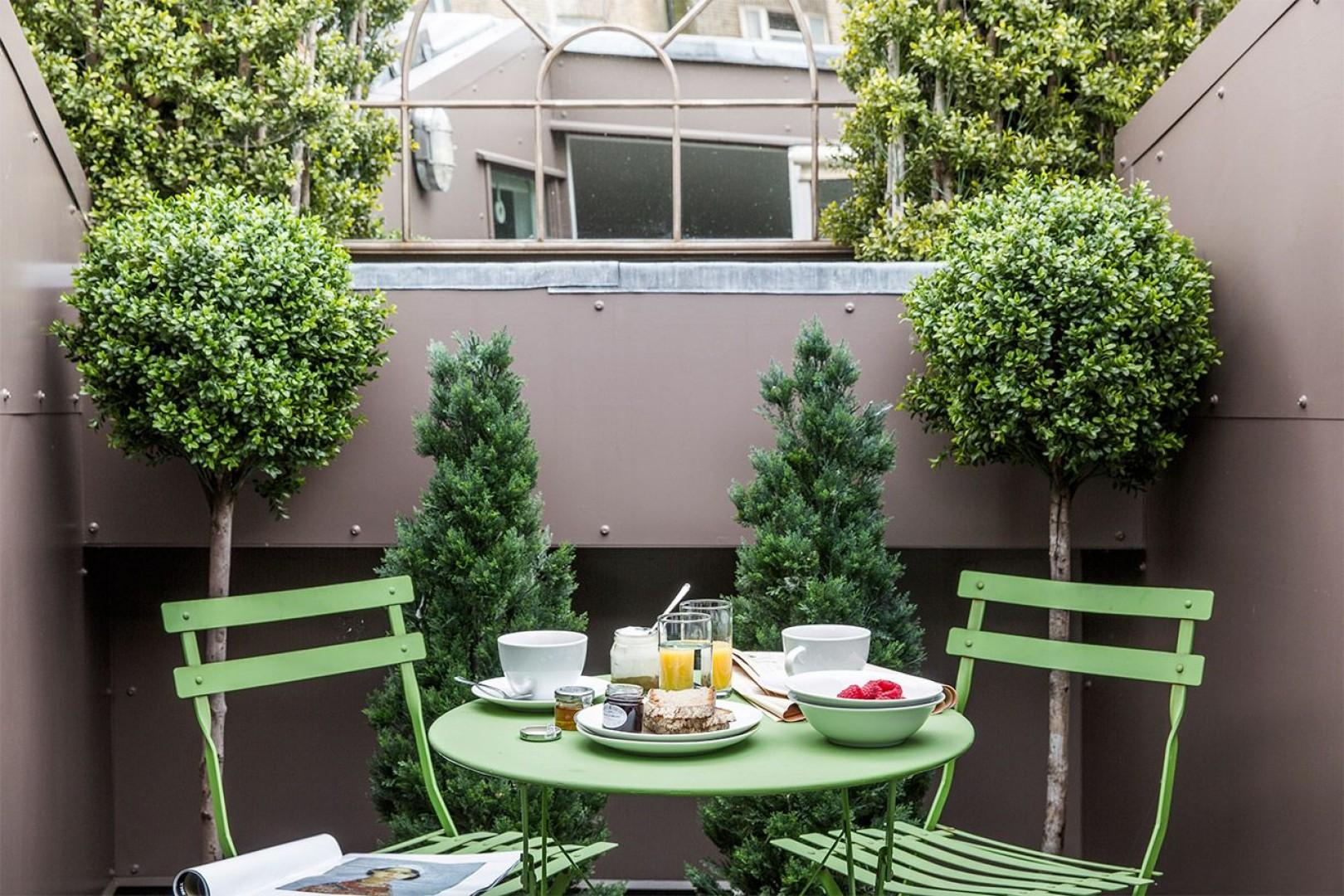 Breakfast on the roof terrace of the Middleton mews home