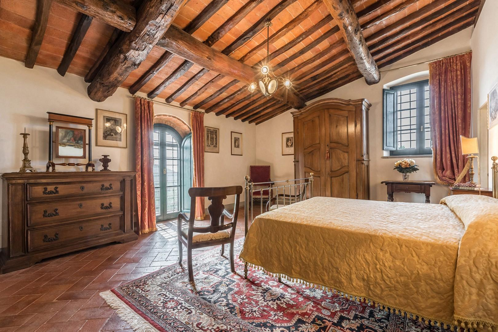 Beautiful beamed ceilings in bedroom 1 with views of Monsummano Alto.