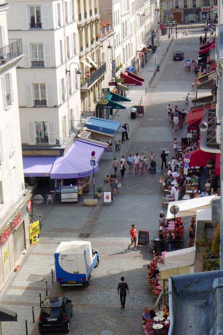 View of the lively Rue Cler market street