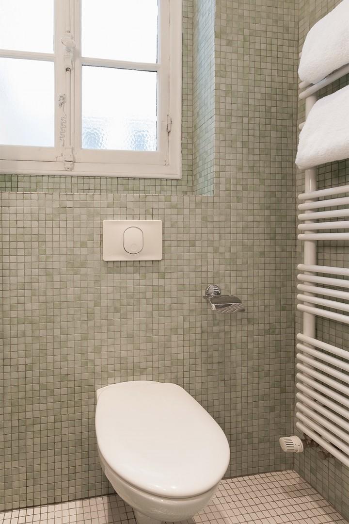 Heated towel racks in bathroom 1