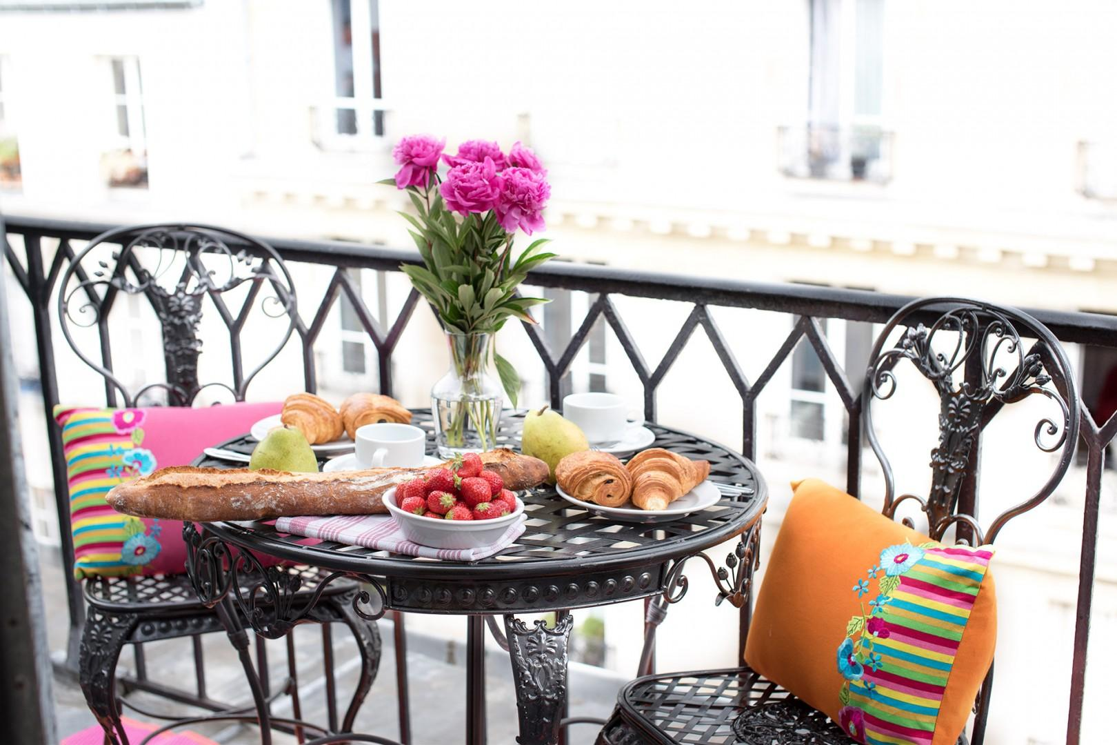 Greet the day over a leisurely breakfast on your balcony.