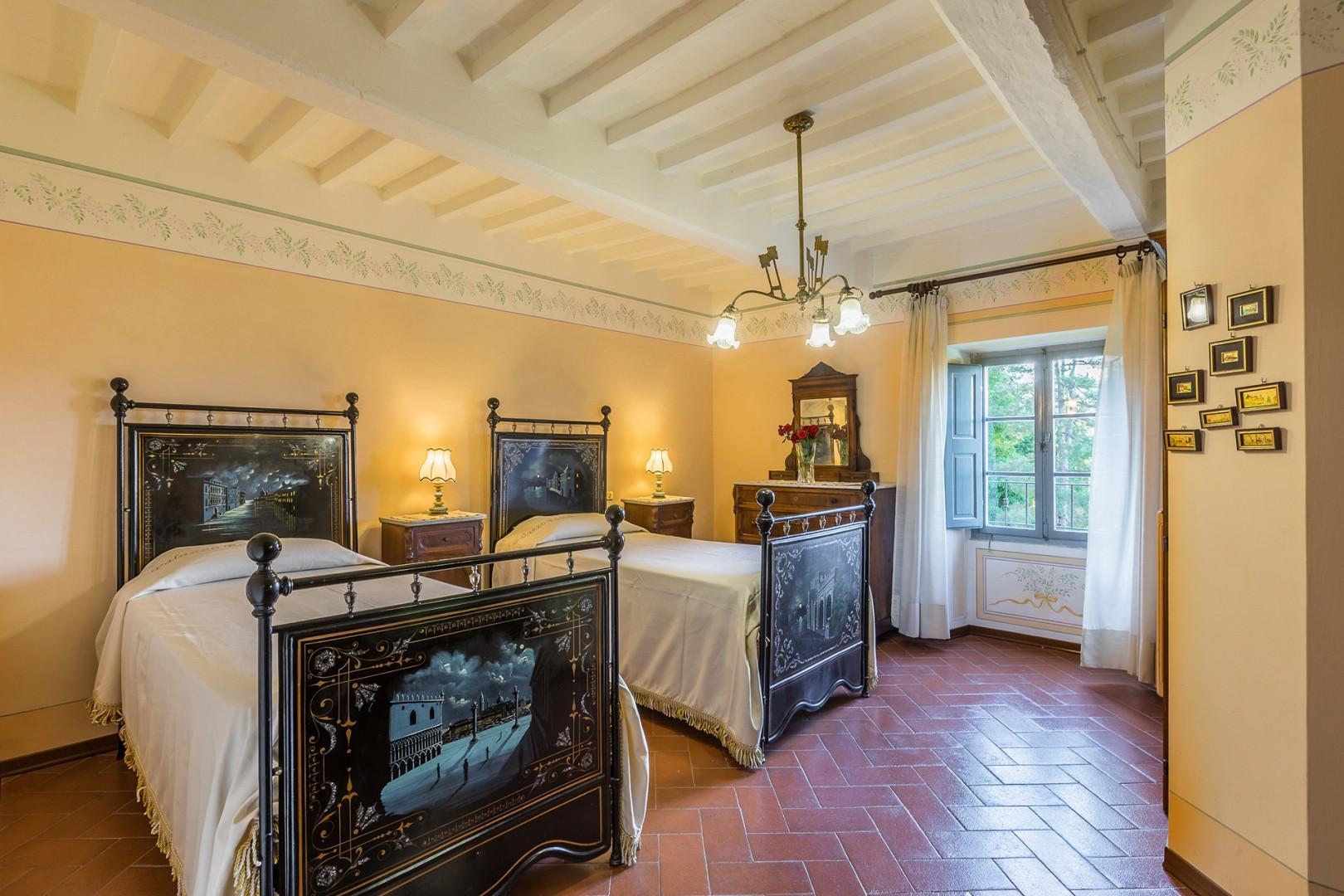 Bedroom 4 has two beds and an en suite bathroom.