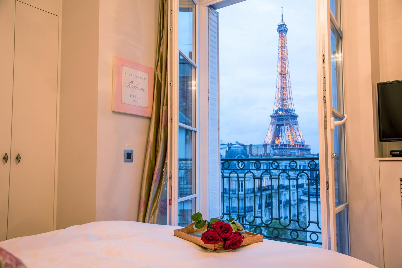 Watch the sunset and the Eiffel Tower light up at night right from your bed!