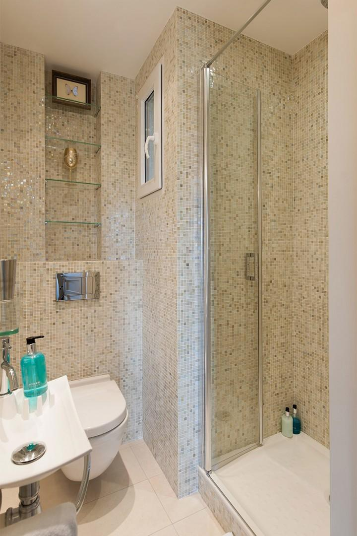 Bathroom 2 is decorated with iridescent glass tiles.