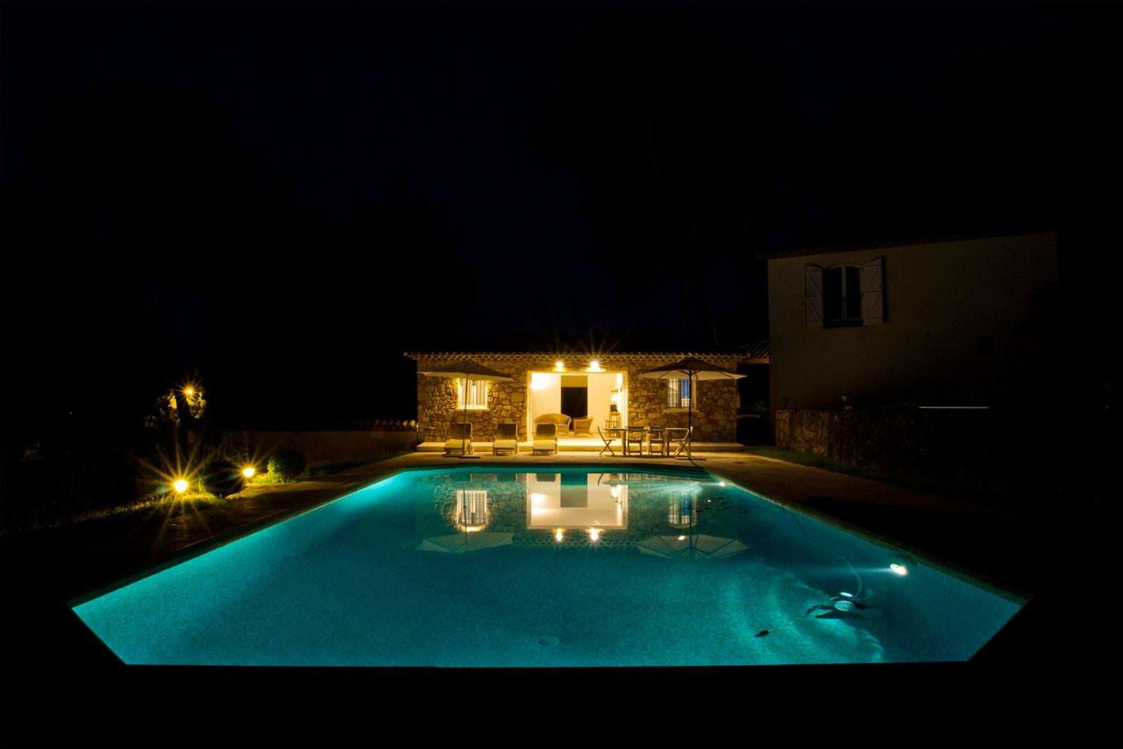 Enjoy a nighttime view of the pool